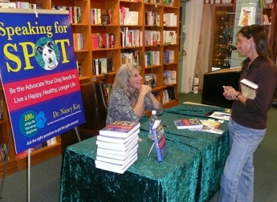 Dr. Nancy Kay discussing her book with a fellow dog lover